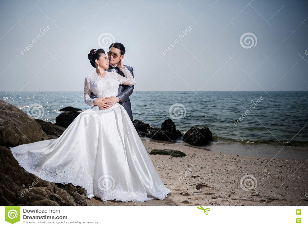 Asian Couple Wearing Wedding Dress And Suit Stock Image - Image of ...