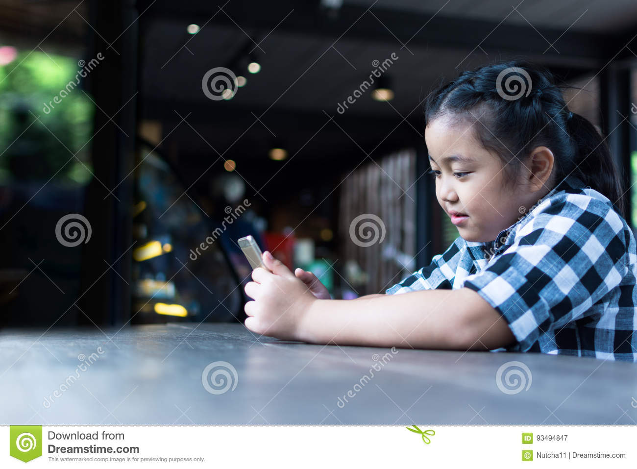 98475108d15 Asian Cute Girl Drinking Milk And Use Smartphone In Coffee Shop ...