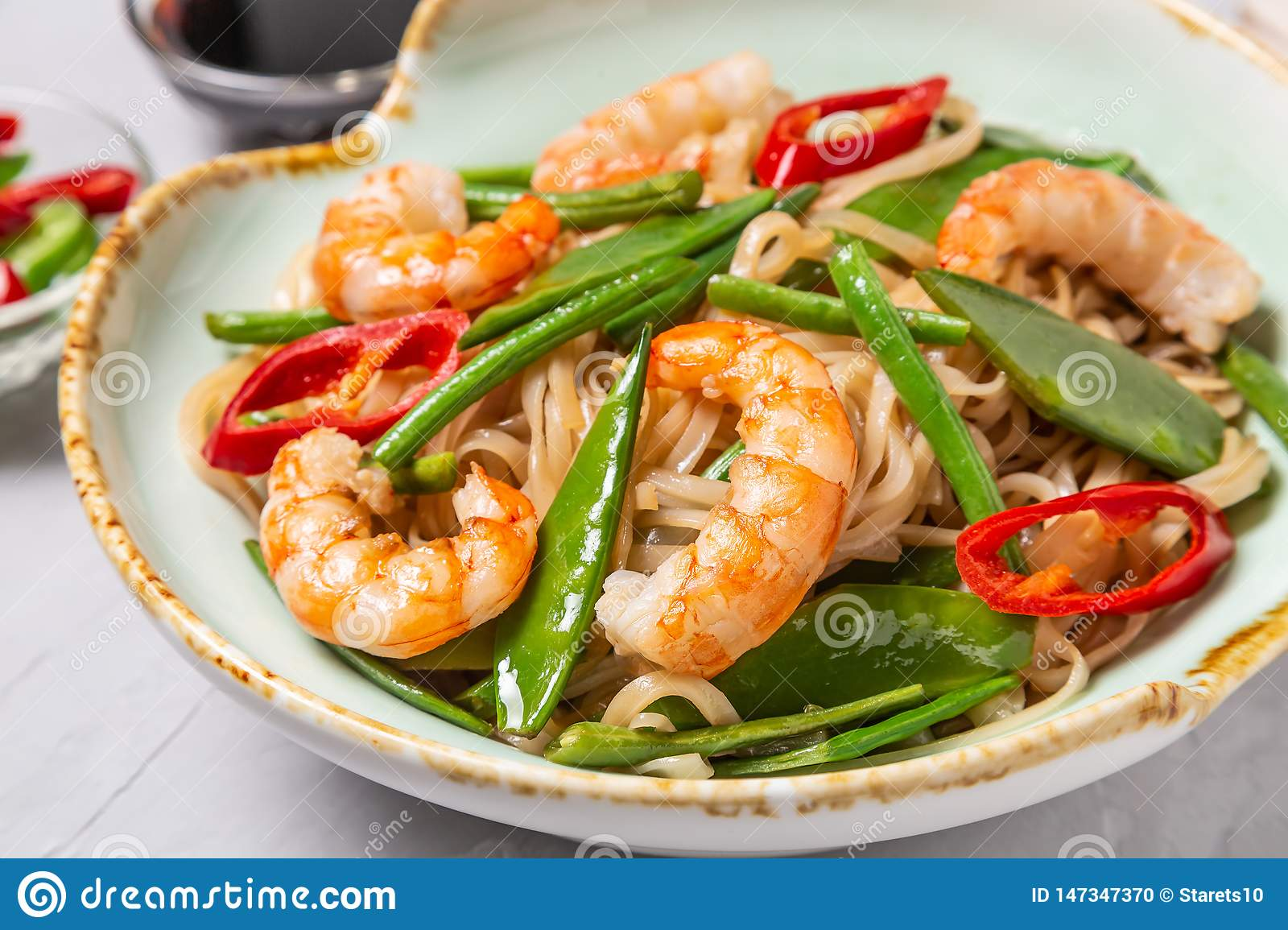 Asian dish of fried rice noodles with shrimp and vegetables