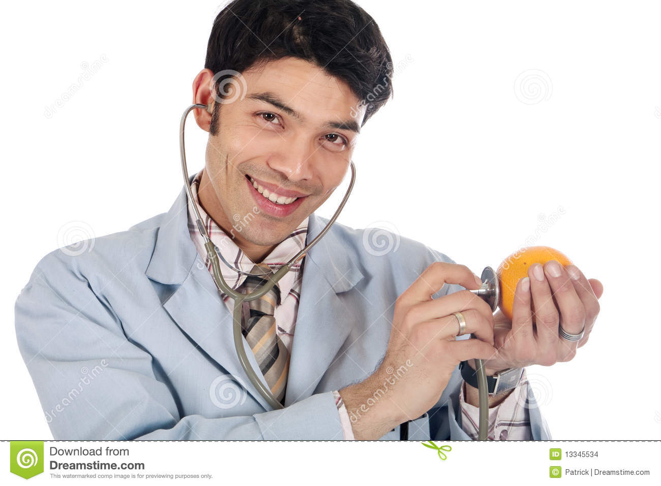 Handsome young Asian Nepalese doctor examining an orange. Studio white ...