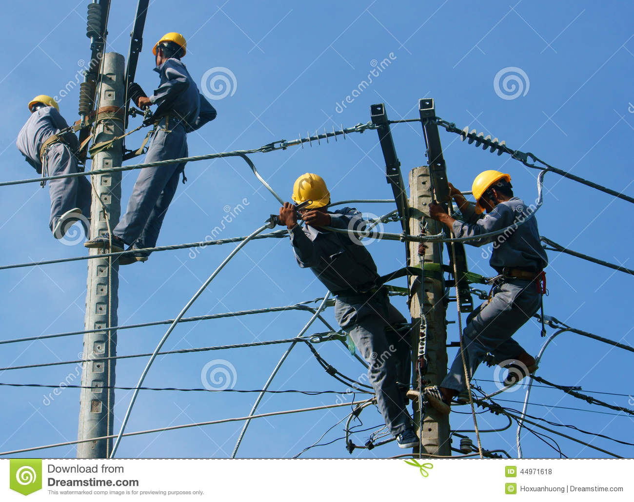 Asian Electrician Climb High, Work On Electric Pole ...