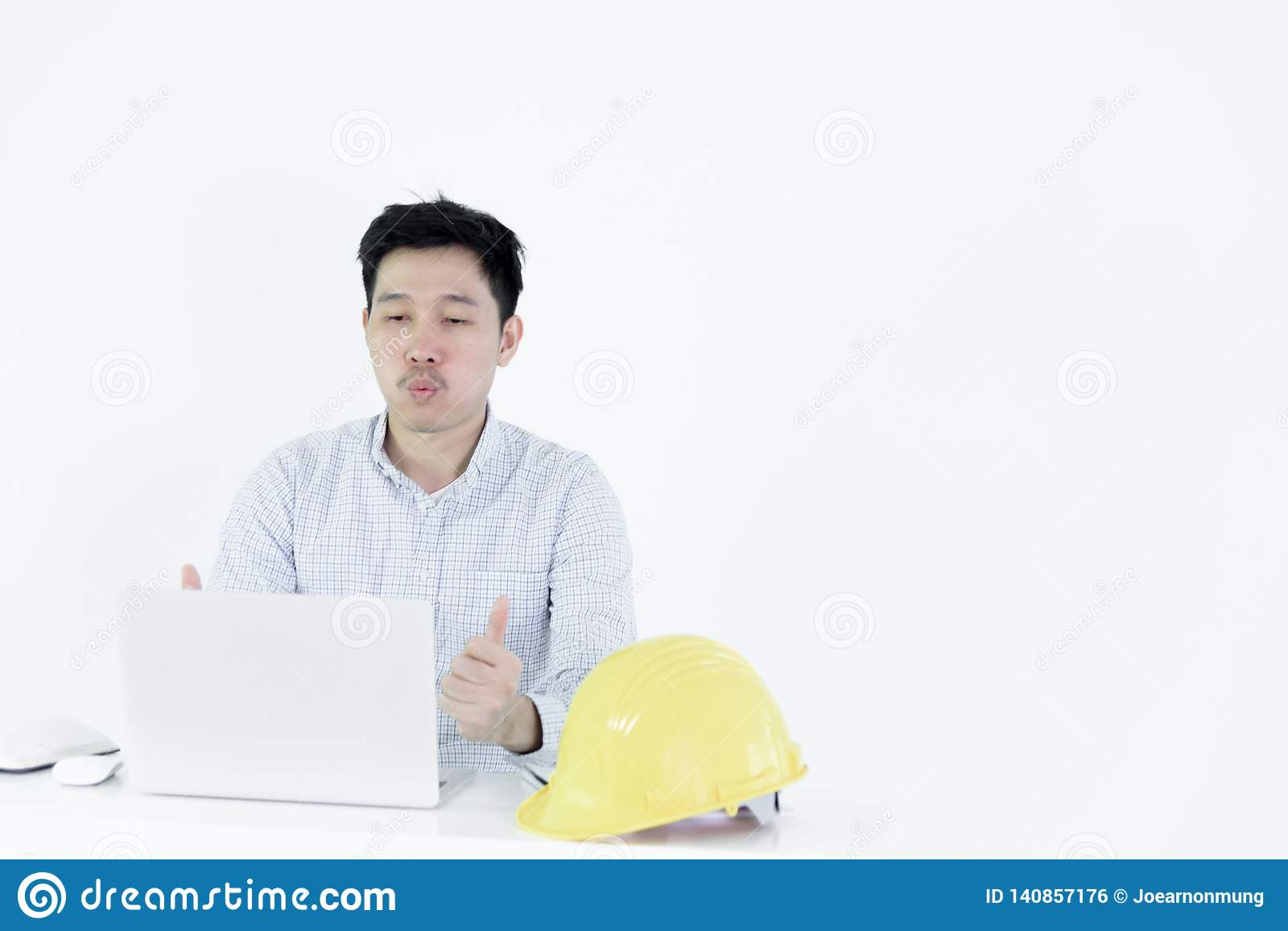 Asian employee engineer salary man sitting at desk and working with feeling successful and victory, isolated on white background