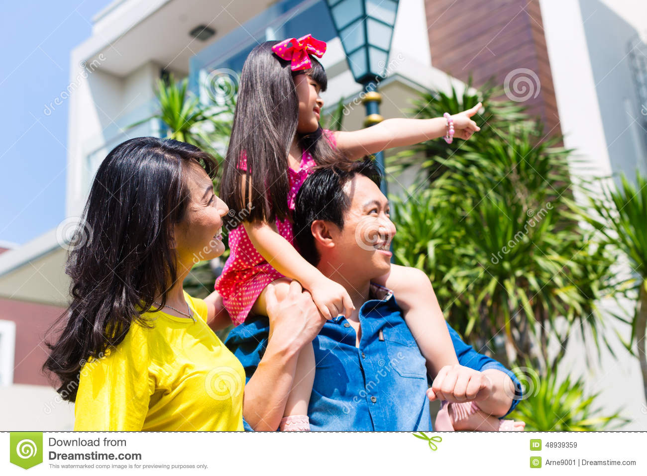 Man Standing In Front Of Bougainvillea Flowers Stock Image ... Happy Asian Family In Front Of House