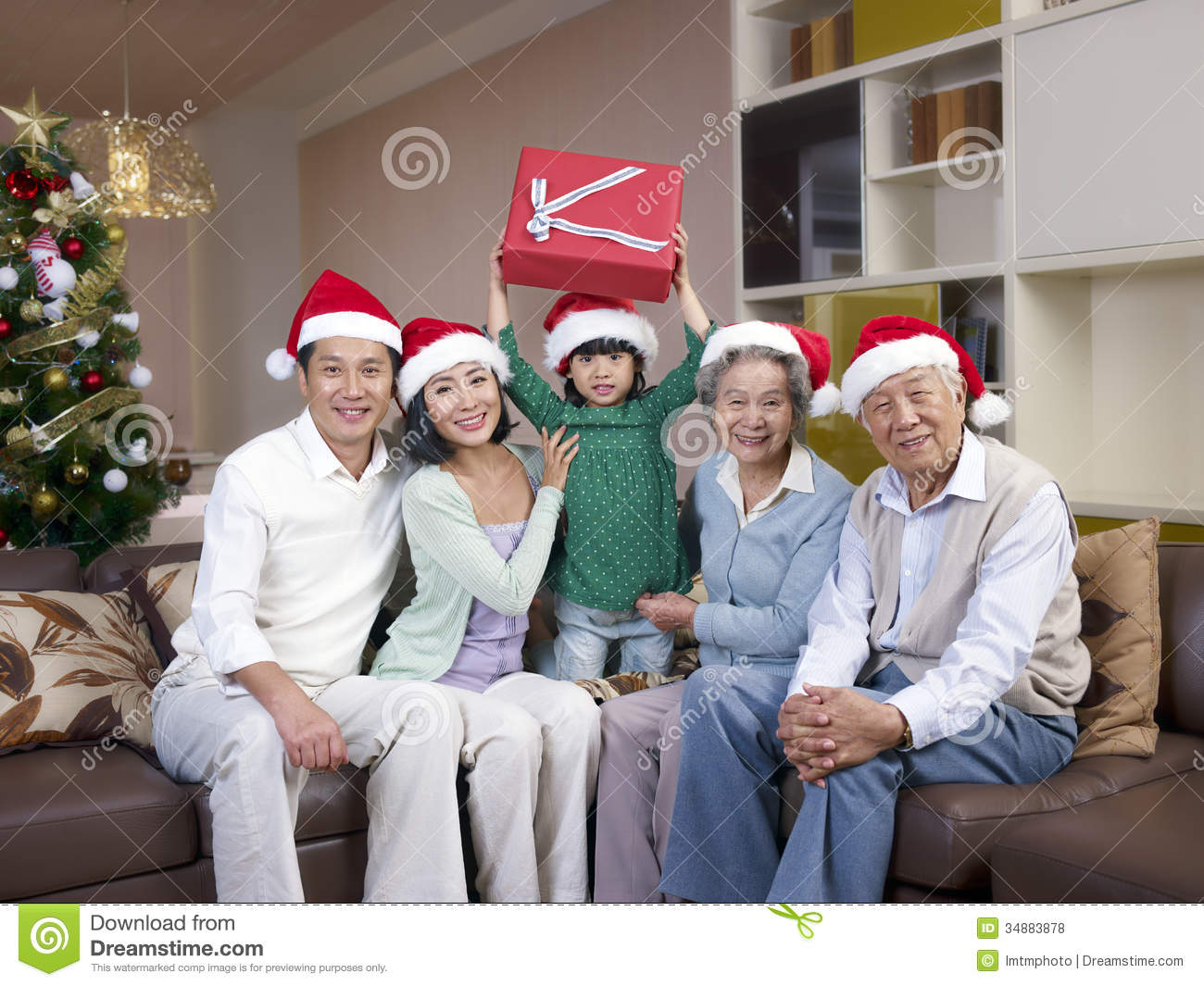 Asian family with christmas hats stock photo image