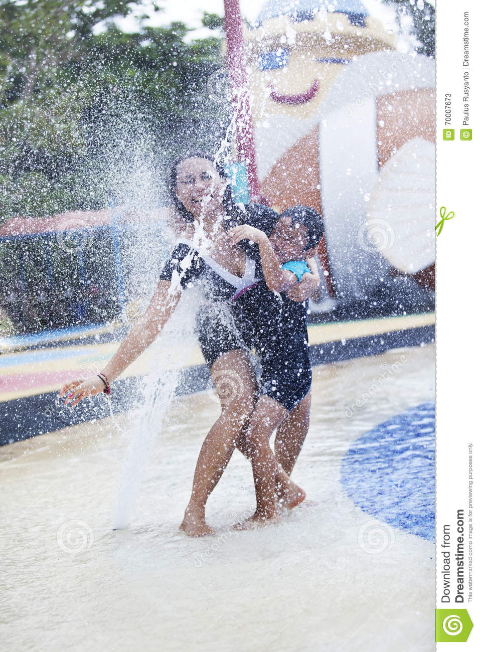 Mother Having A Quality Time At Swimming Pool Stock Photo 24484026