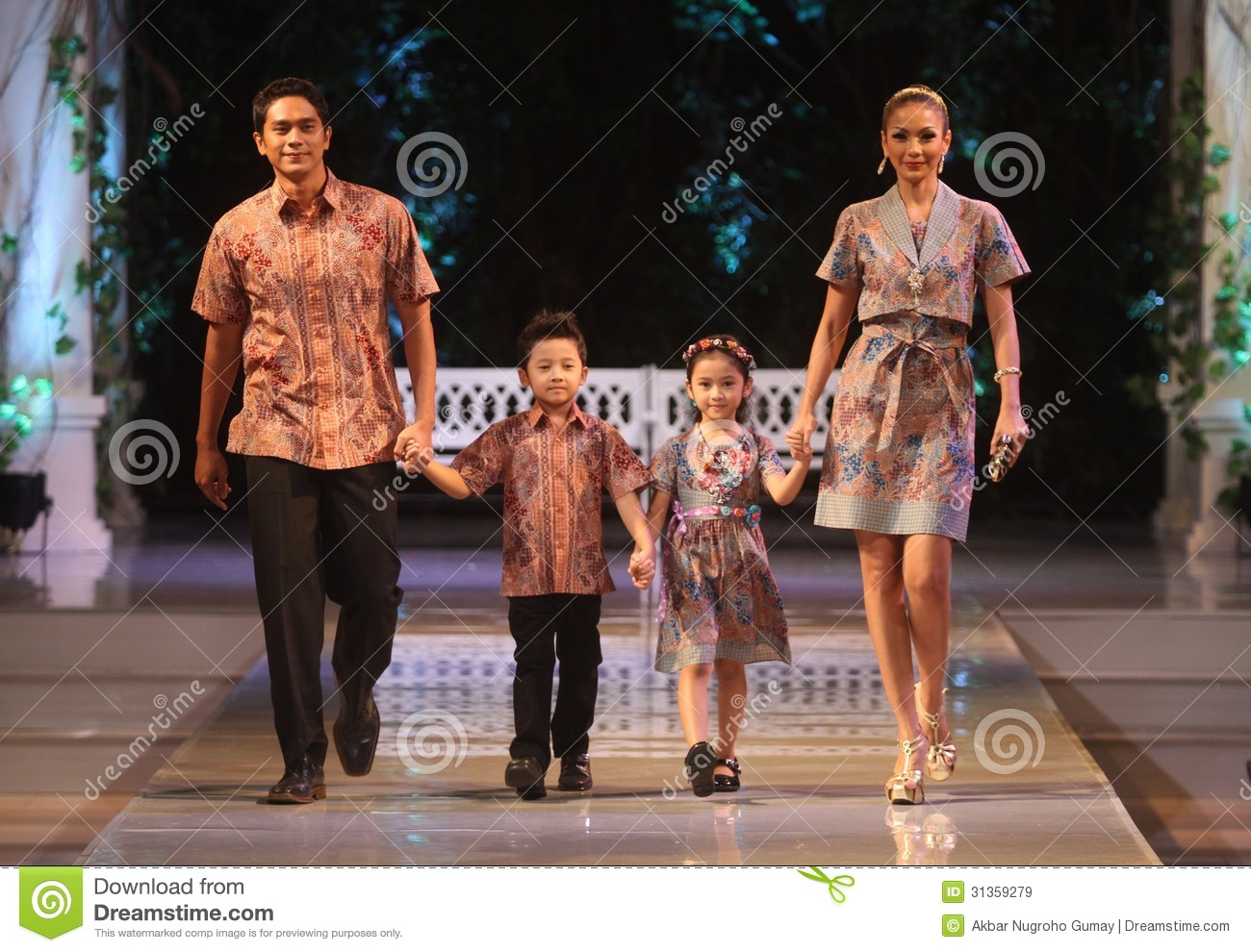 Asian family model wearing indonesian traditional batik at batik keris ...