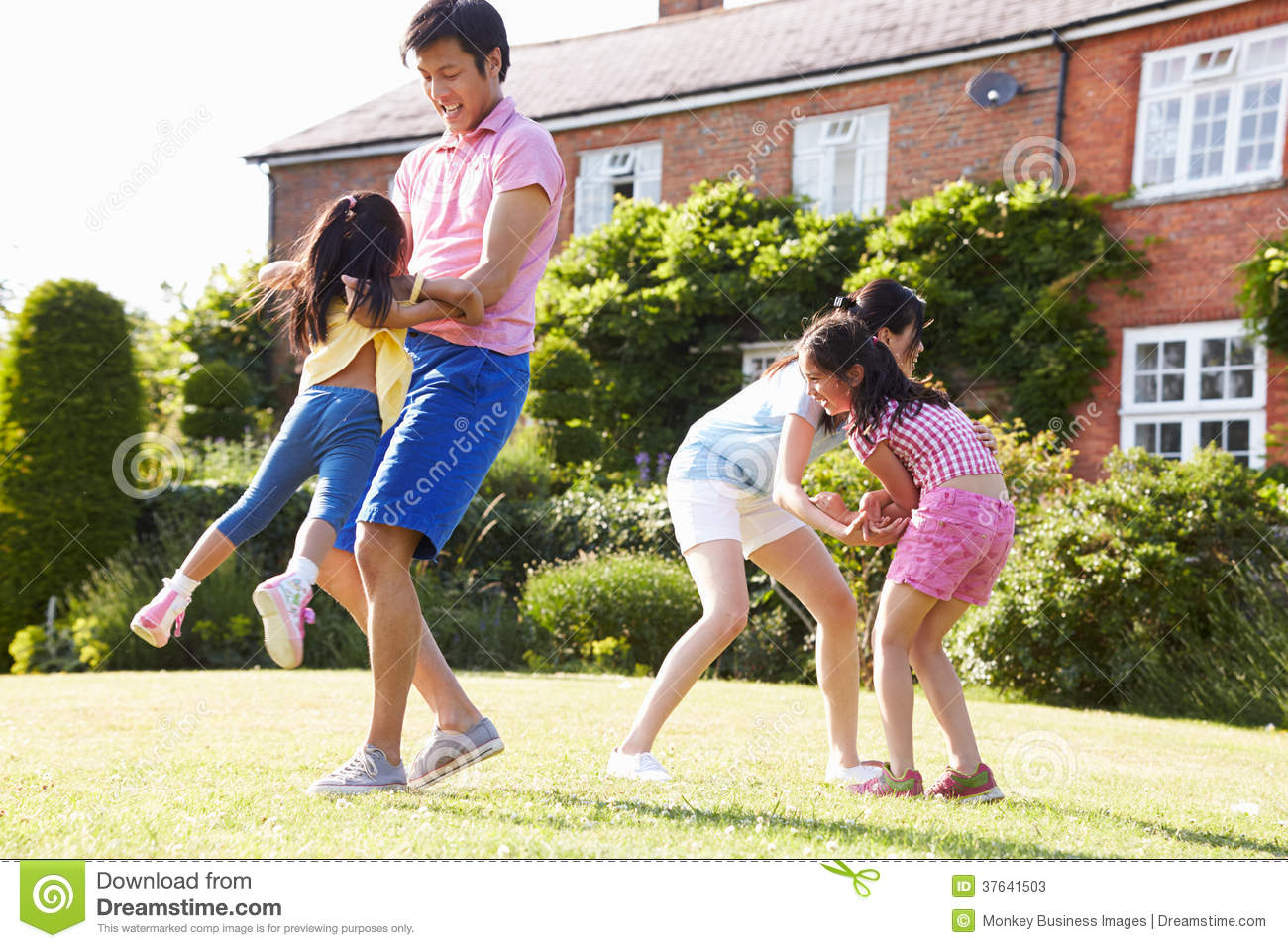 Asian Family Playing In Summer Garden Together Stock Image