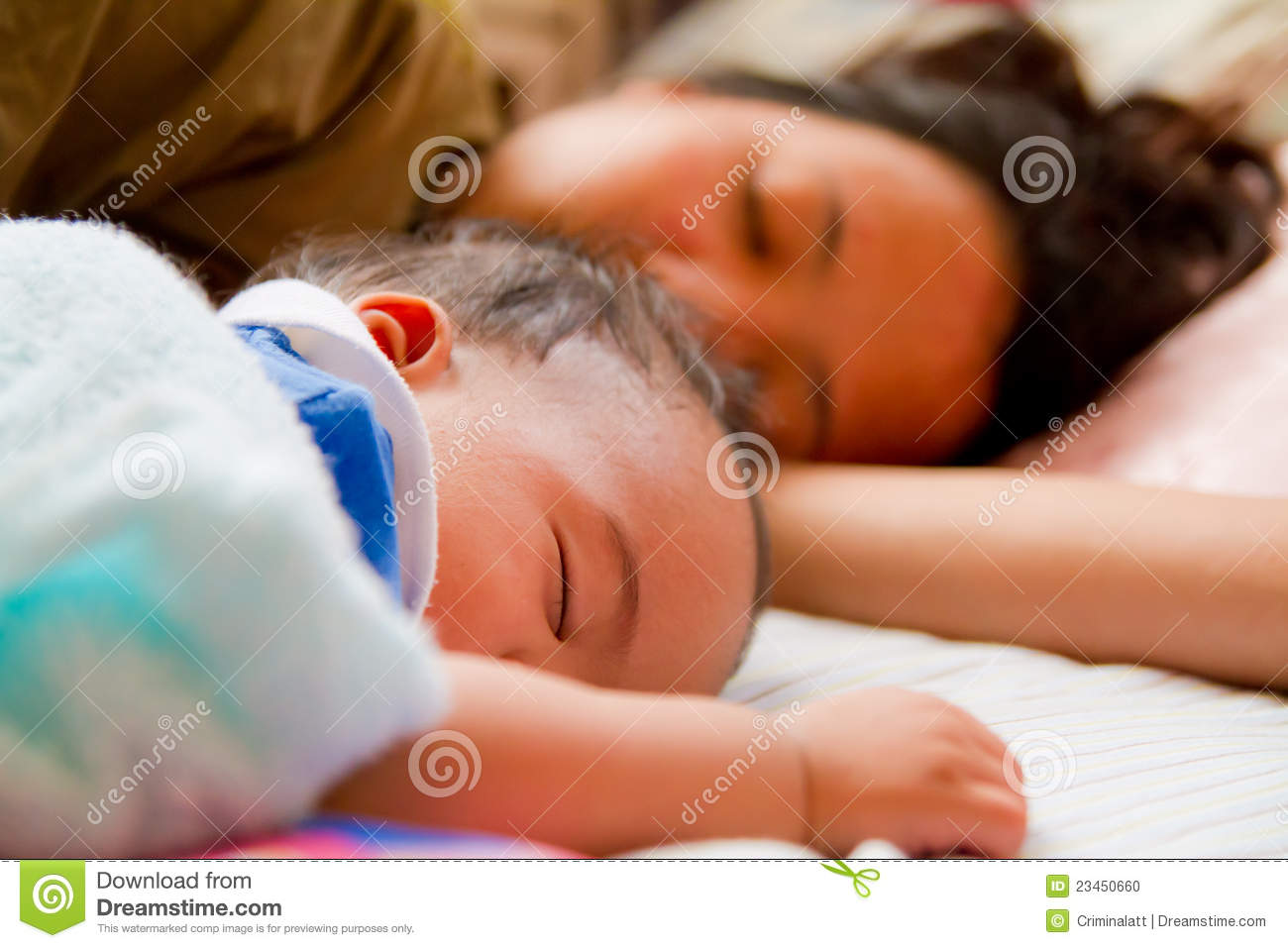 Asian female baby sleeping with her mother