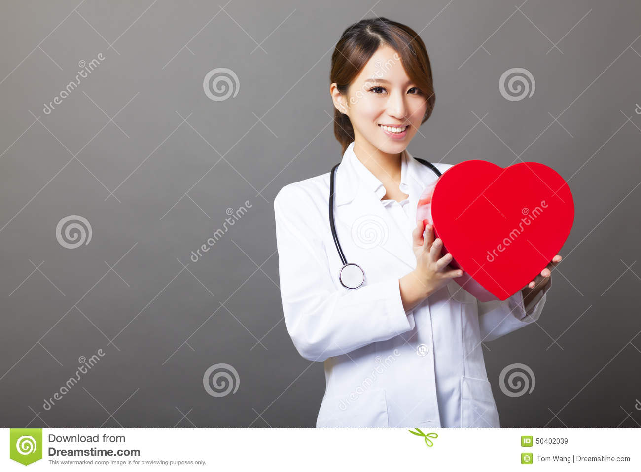 asian female doctor with heart