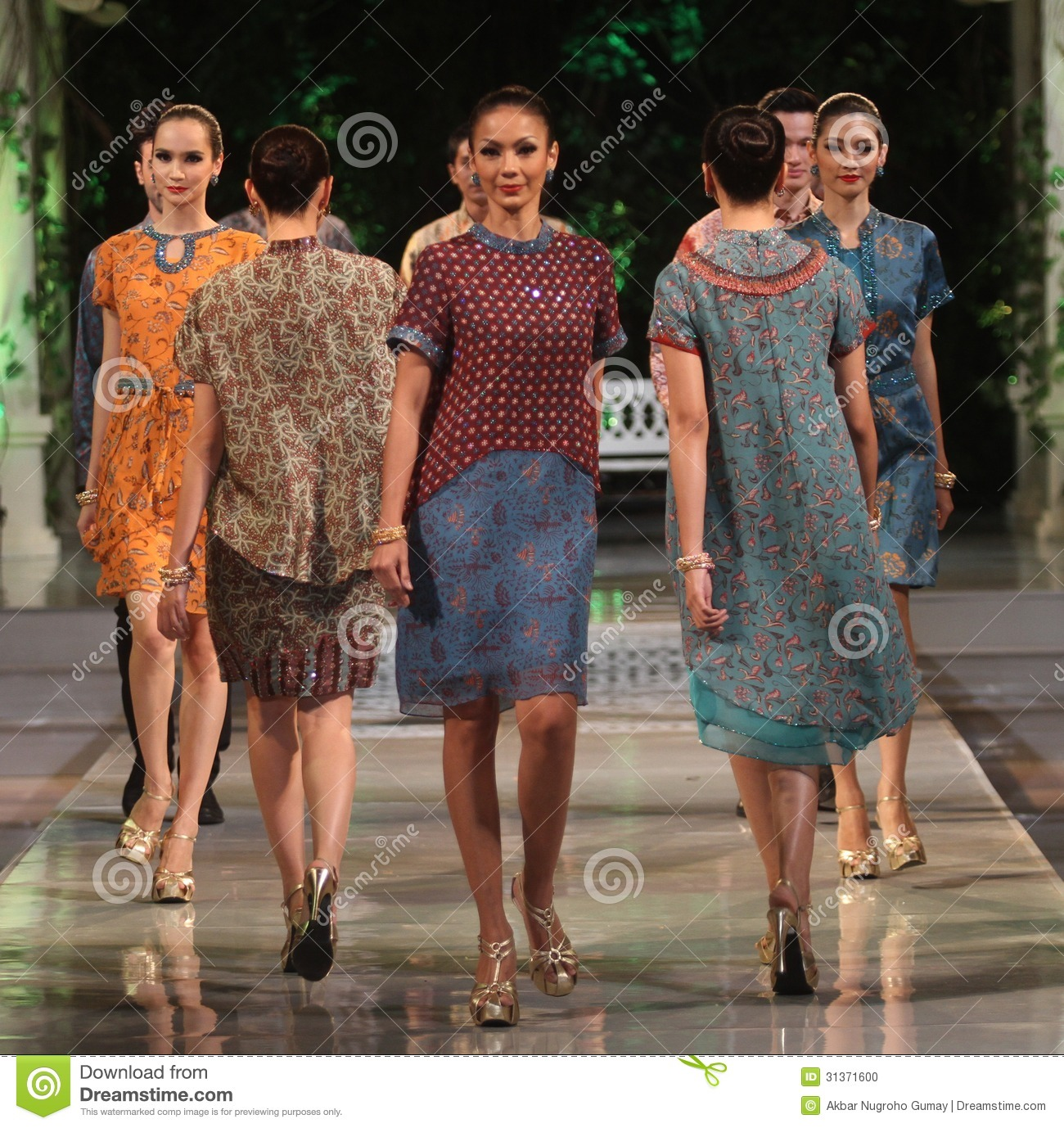 Asian female model wearing indonesian traditional batik at batik keris ...