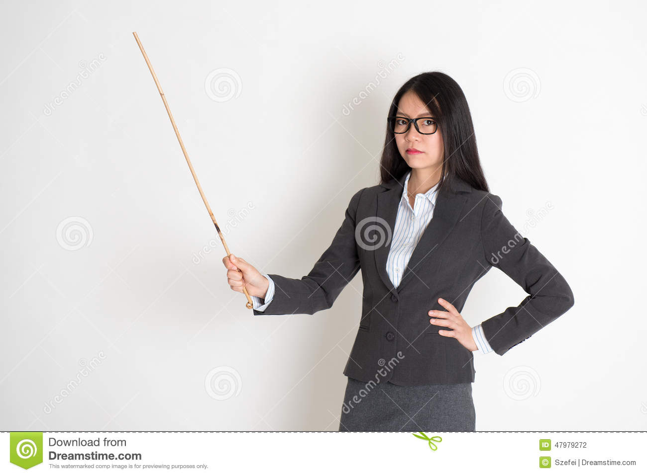 Asian female teacher in serious expression