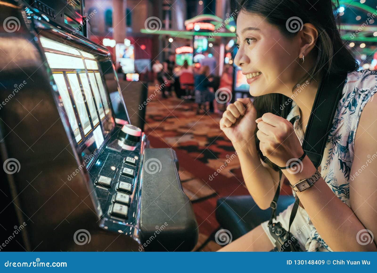 Asian gambling in casino playing slot machines