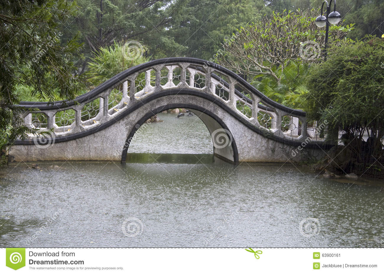 Asian Garden With Traditional Arch Bridge