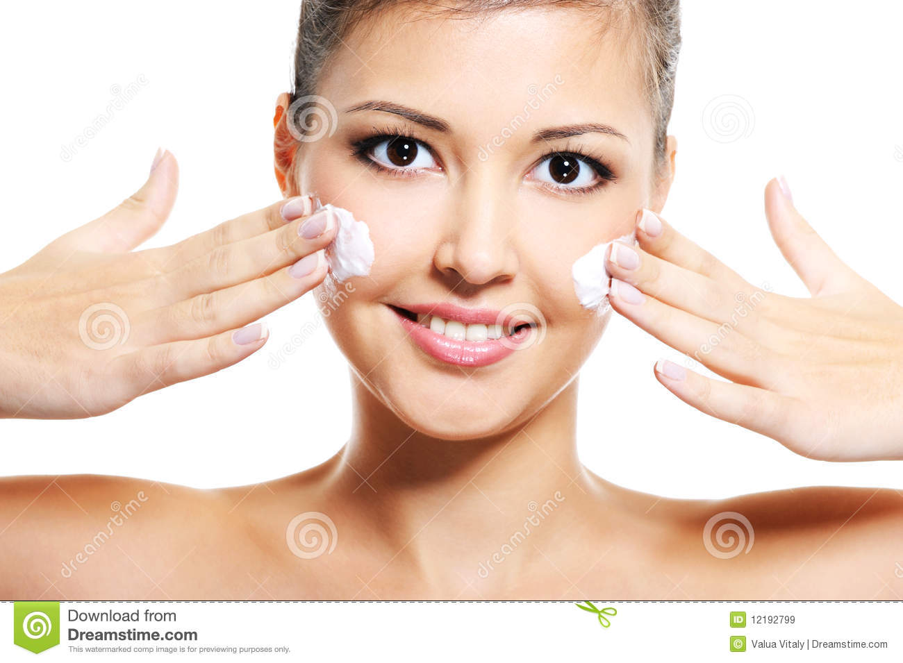 Asian girl apply cosmetic cream on face