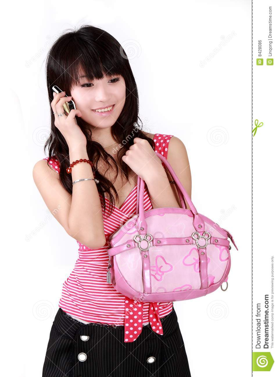 Asian girl on cell phone.