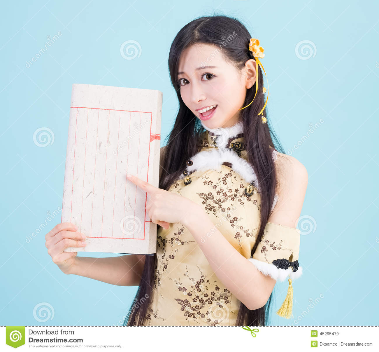 asian girl in cheongsam qipao with chinese book stock