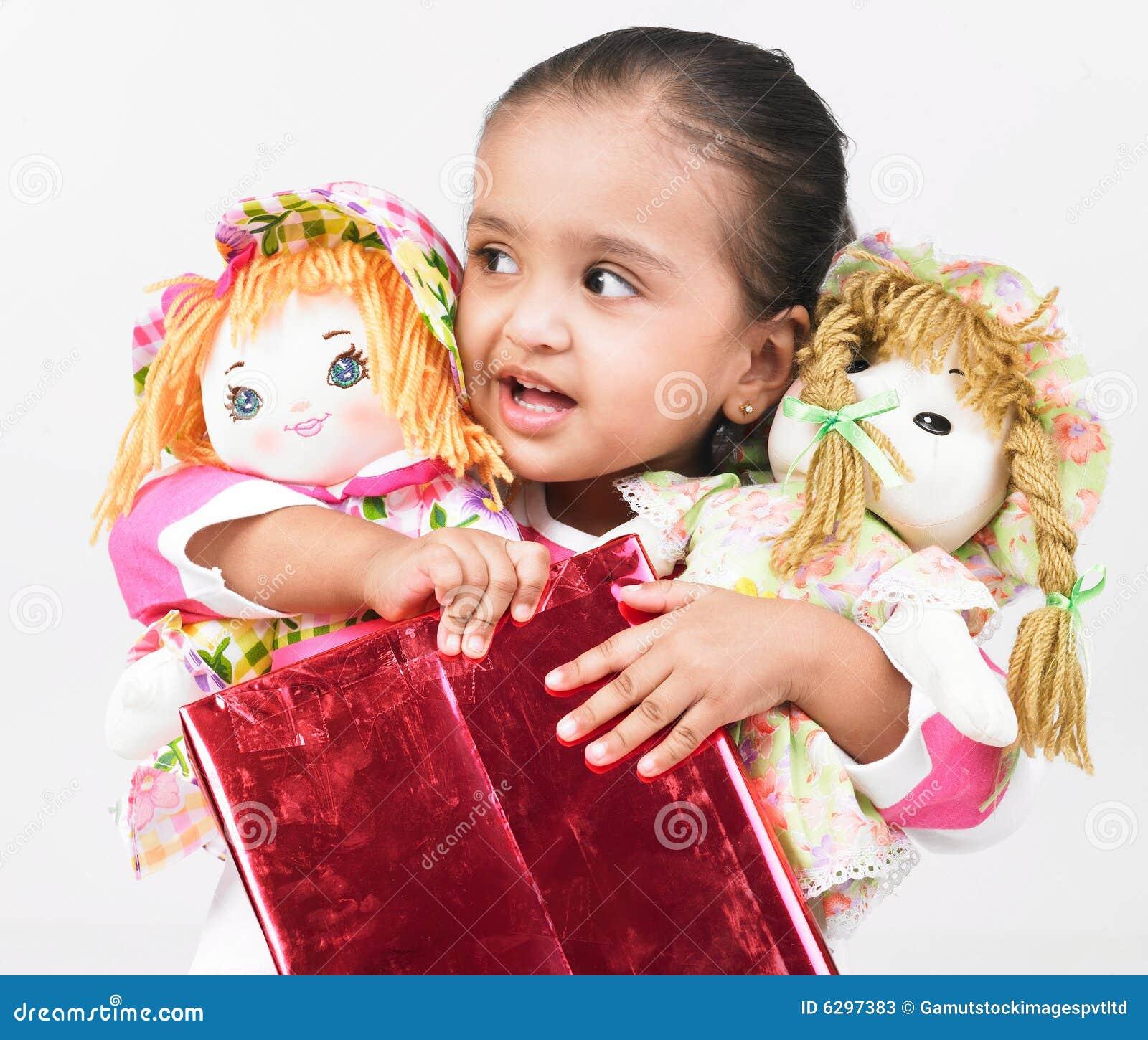 asian girl with dolls stock photos   image 6297383