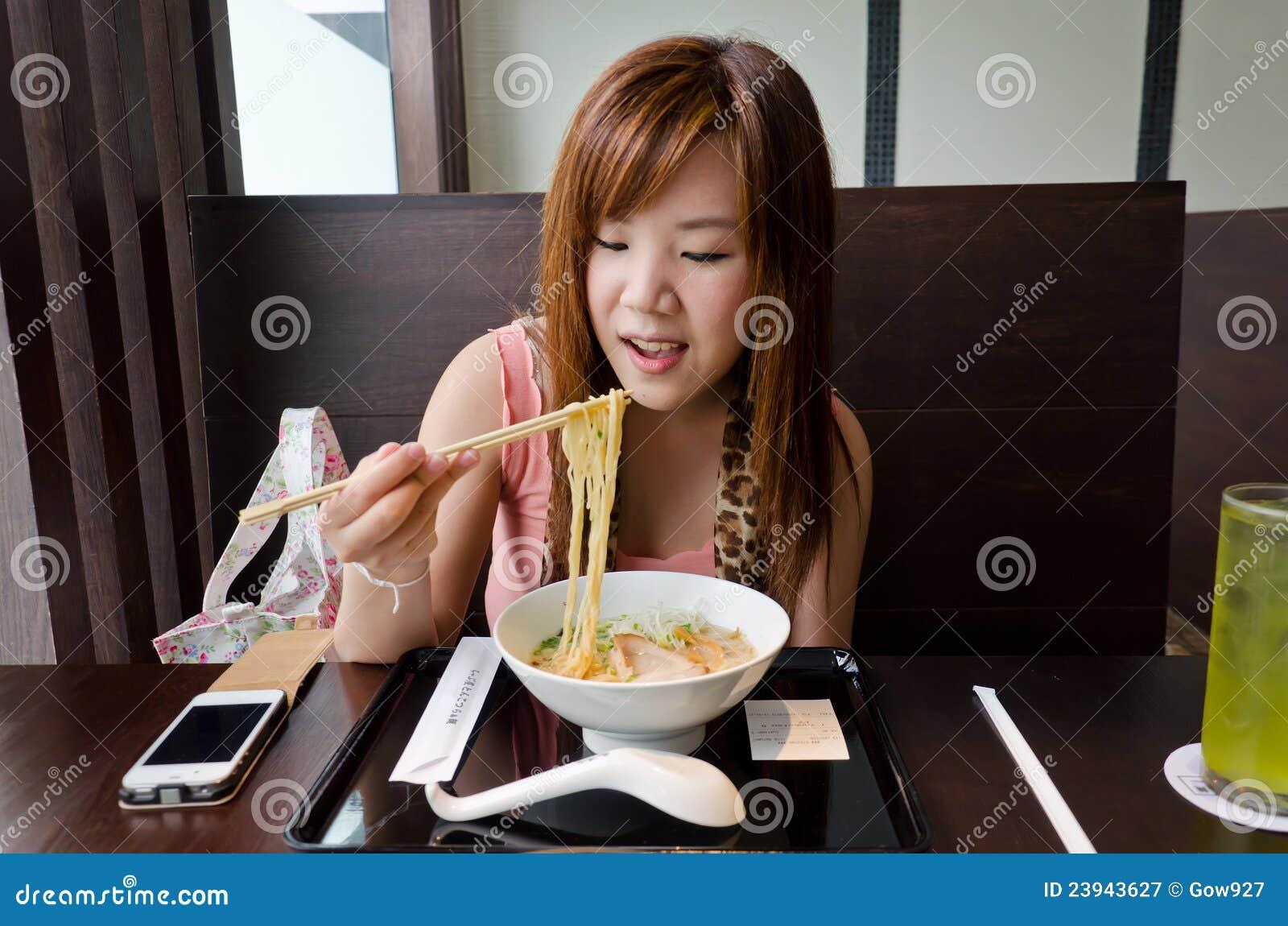 Asian girl eating japanese ramen royalty free stock for Japanese eating table