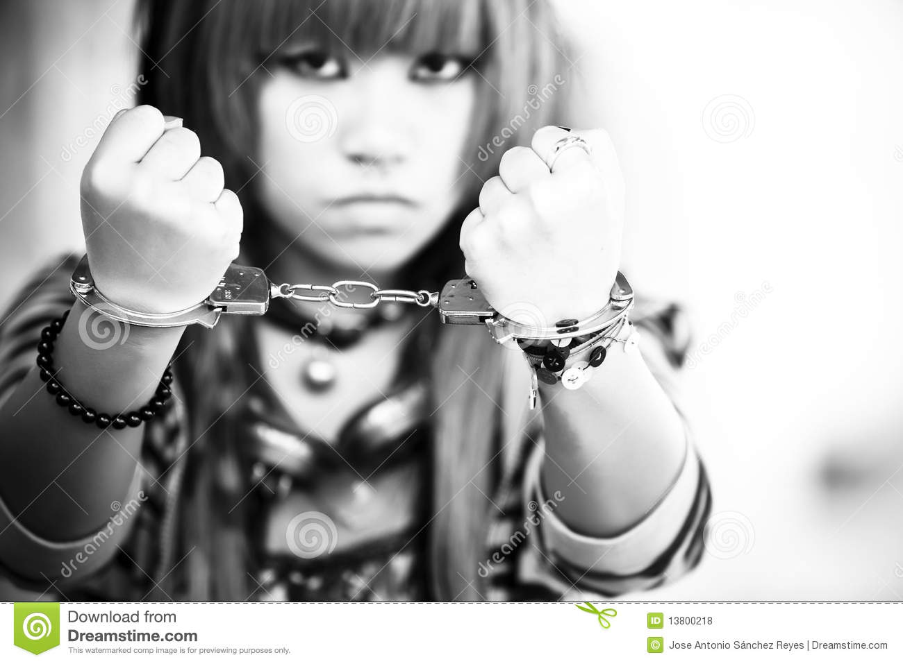 Asian girl with handcuffs