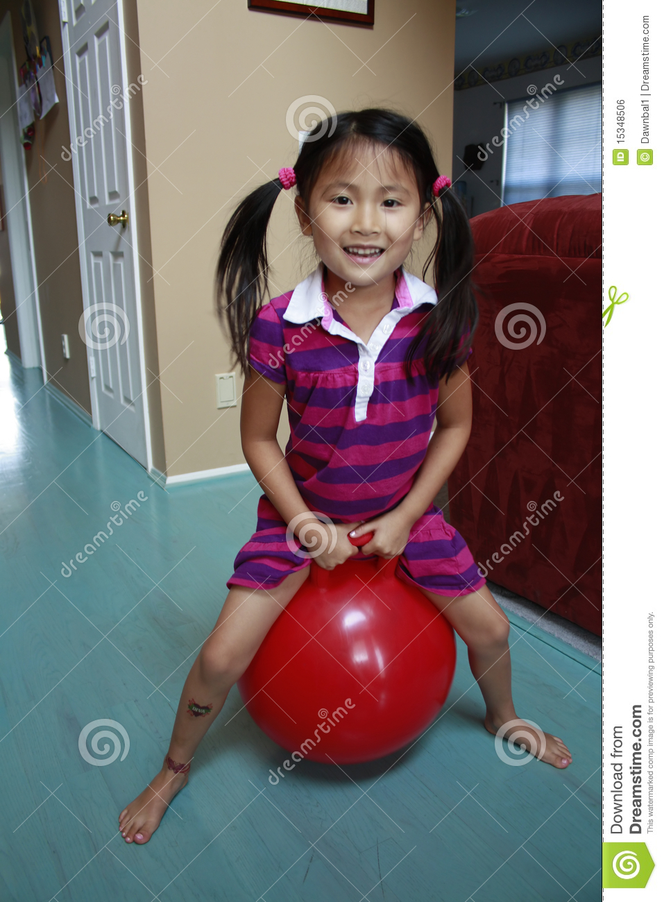 Asian Girl Hopping On Red Ball Stock Photo - Image Of -7878