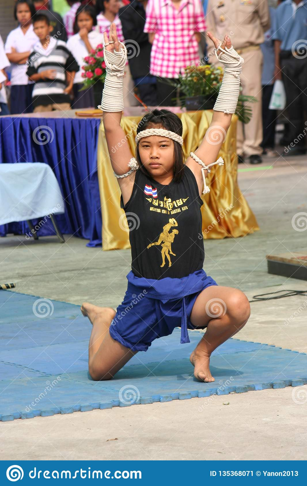 Asian girl is showing the MUAY THAI DANCE.