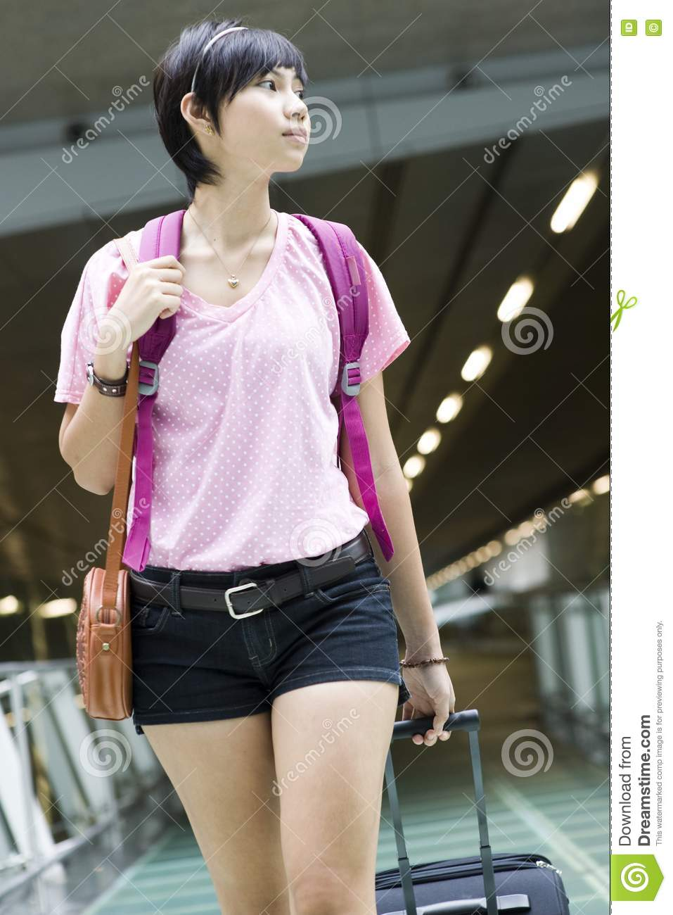asian girl at singapore s changi airport terminal stock