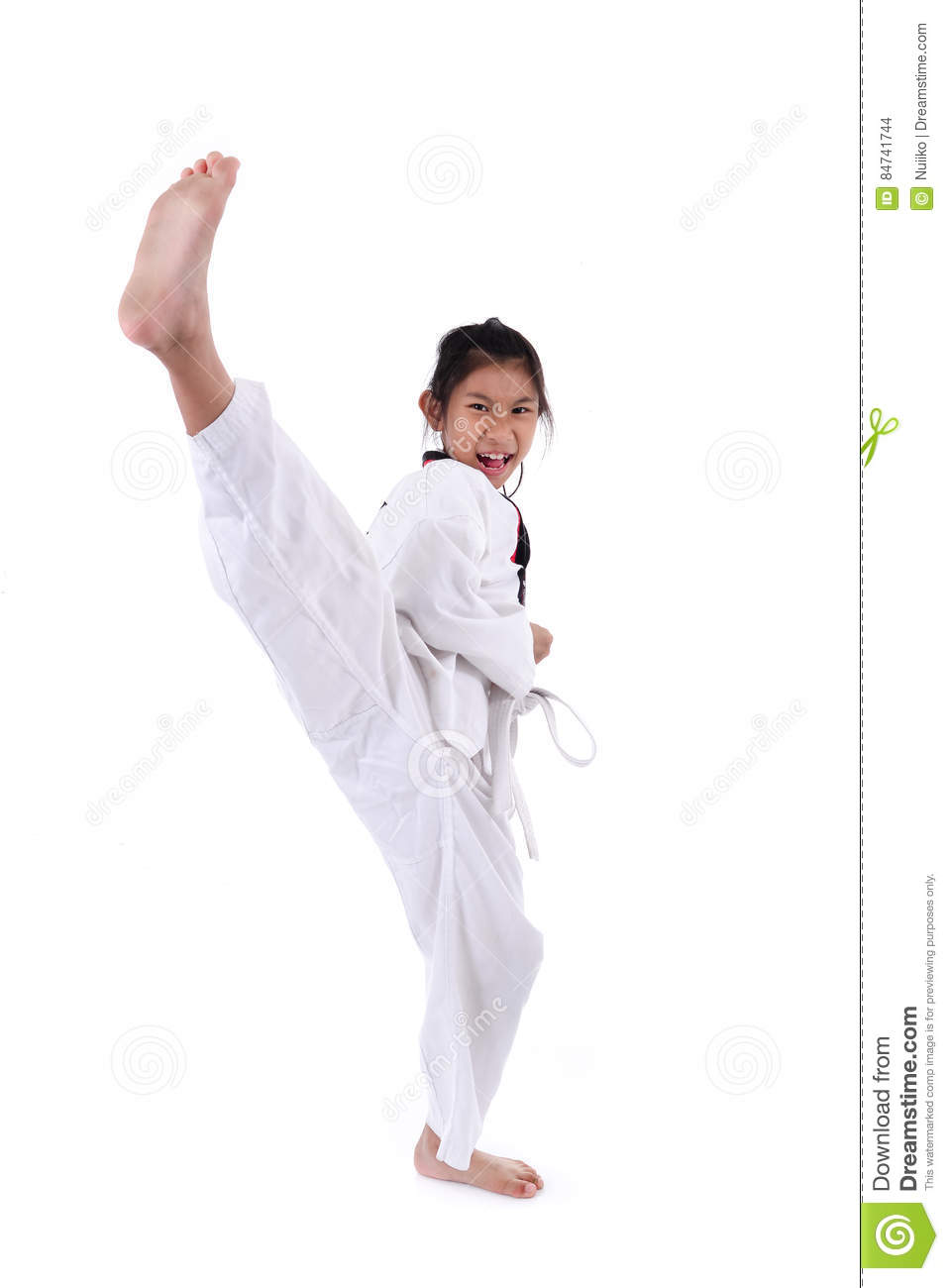 Asian girl stretching leg in martial arts practice training kick.
