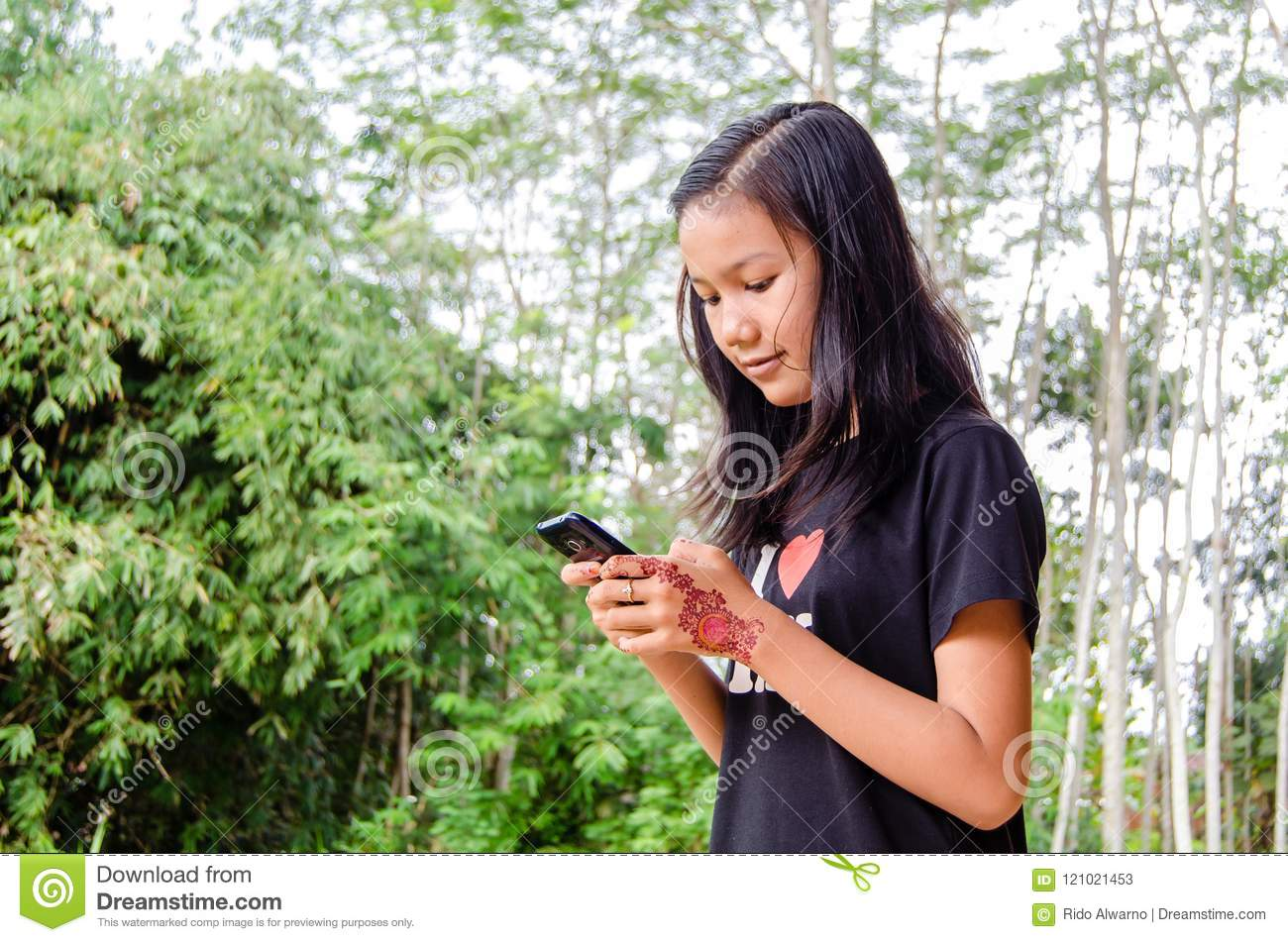 A girl is using a smartphone