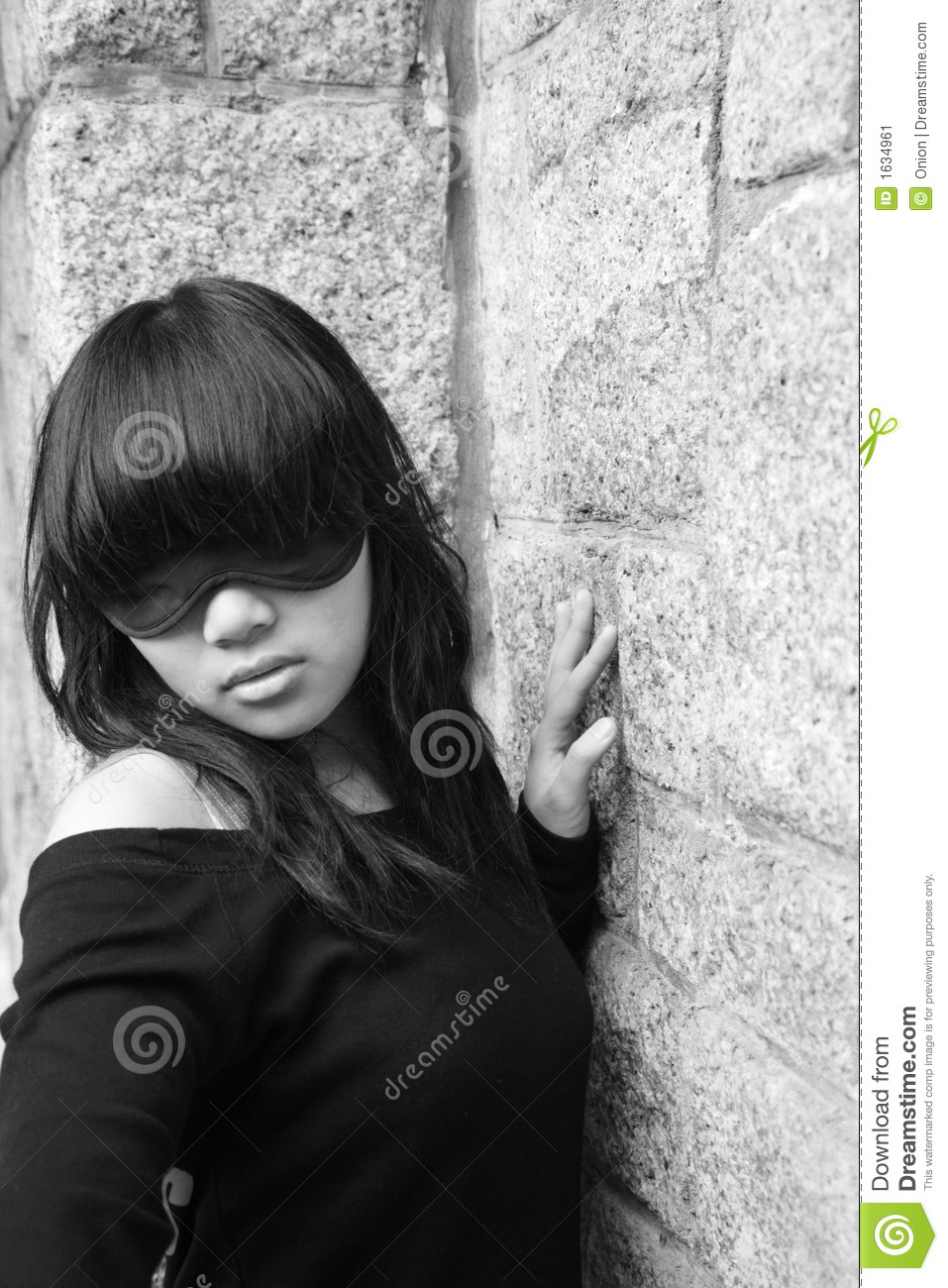 Asian girl wearing a blindfold covering her eyes