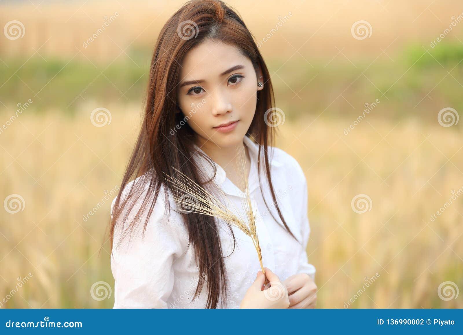 Asian girl at wheat field