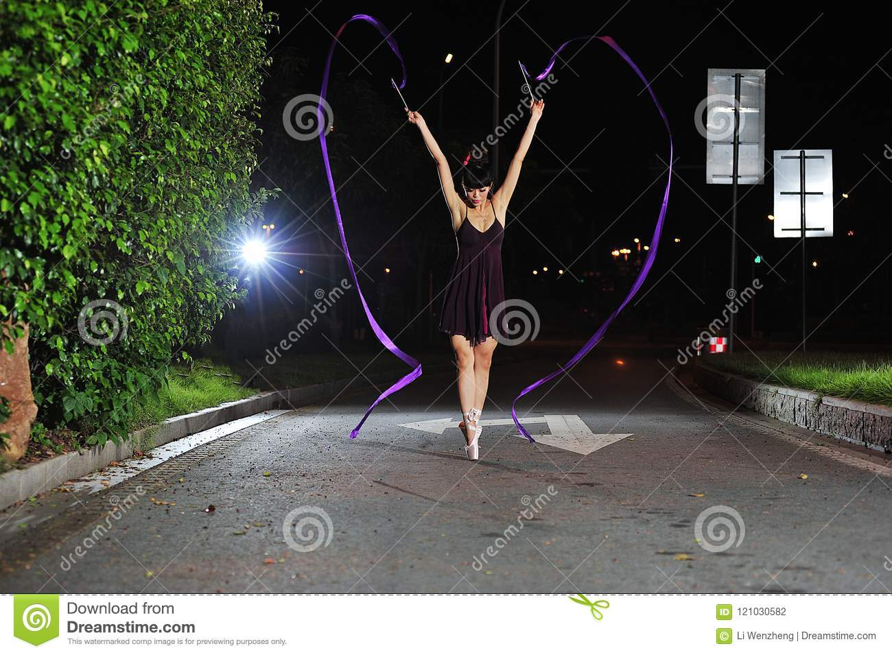 Asian girls dancing ballet on the road at night