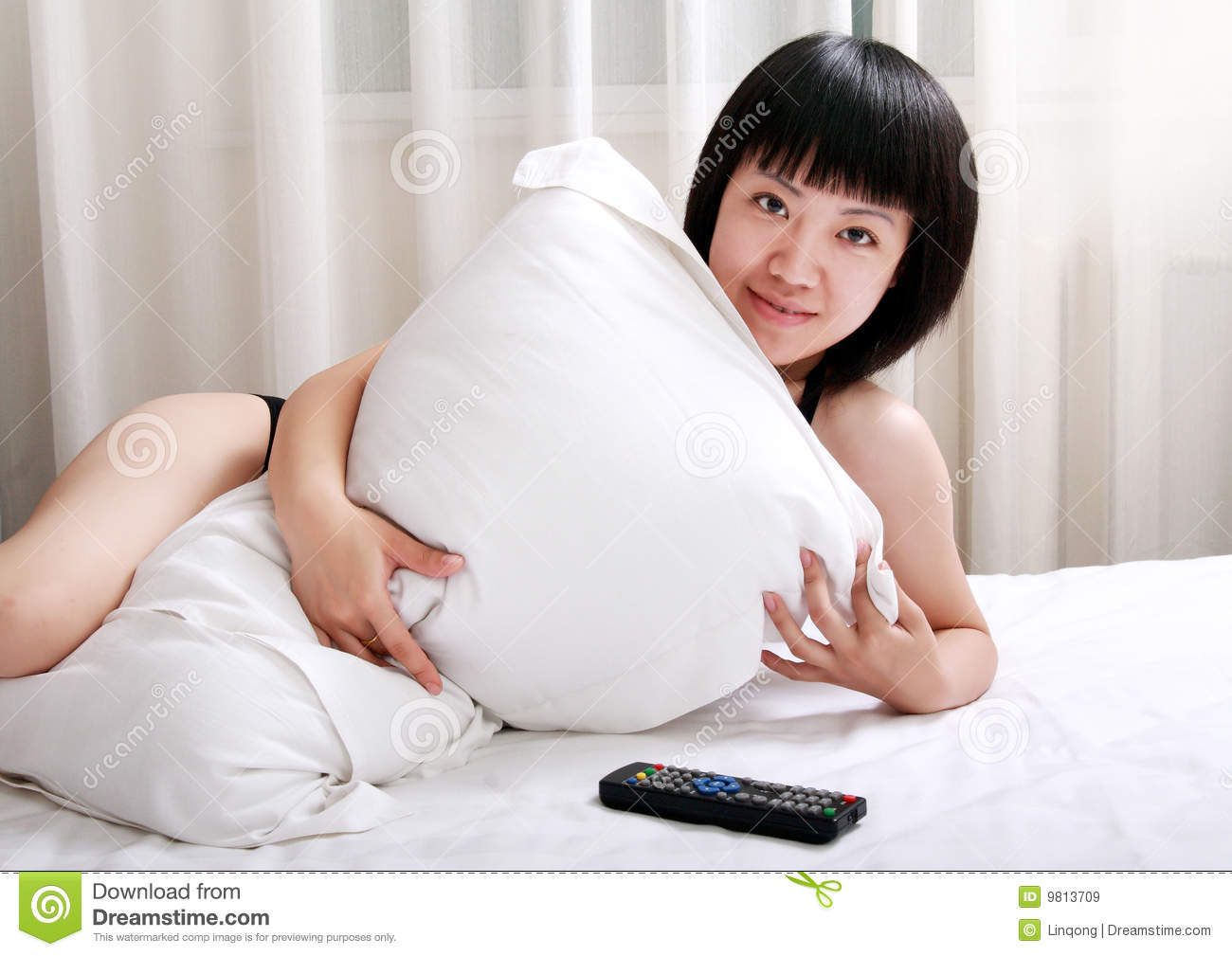 Asian Girls Lying On Bed Stock Image Image Of Control - 9813709-3258