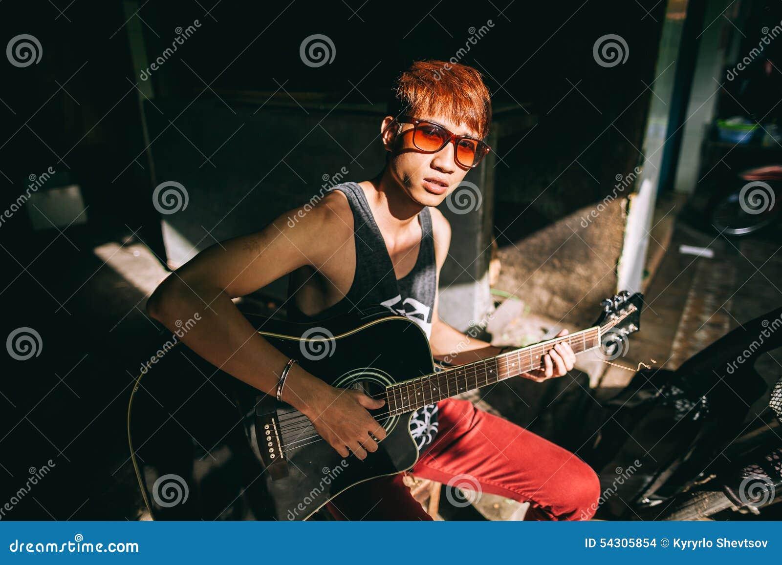 a43c610d38 Asian Guitarist Artist Man Play Guitar On Street Stock Photo - Image ...