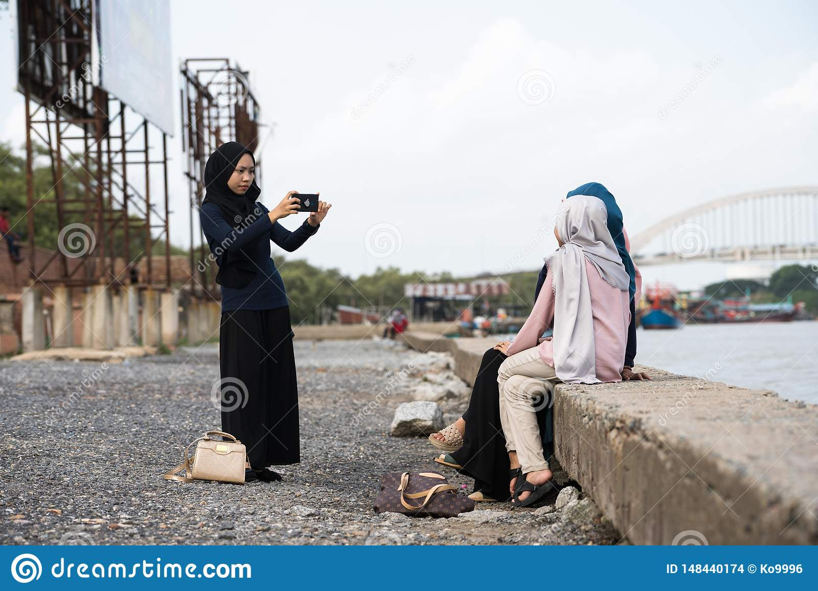 Asian Hijab Girl Taking Photo Editorial Stock Image - Image Of Friends, Adult 148440174-8419