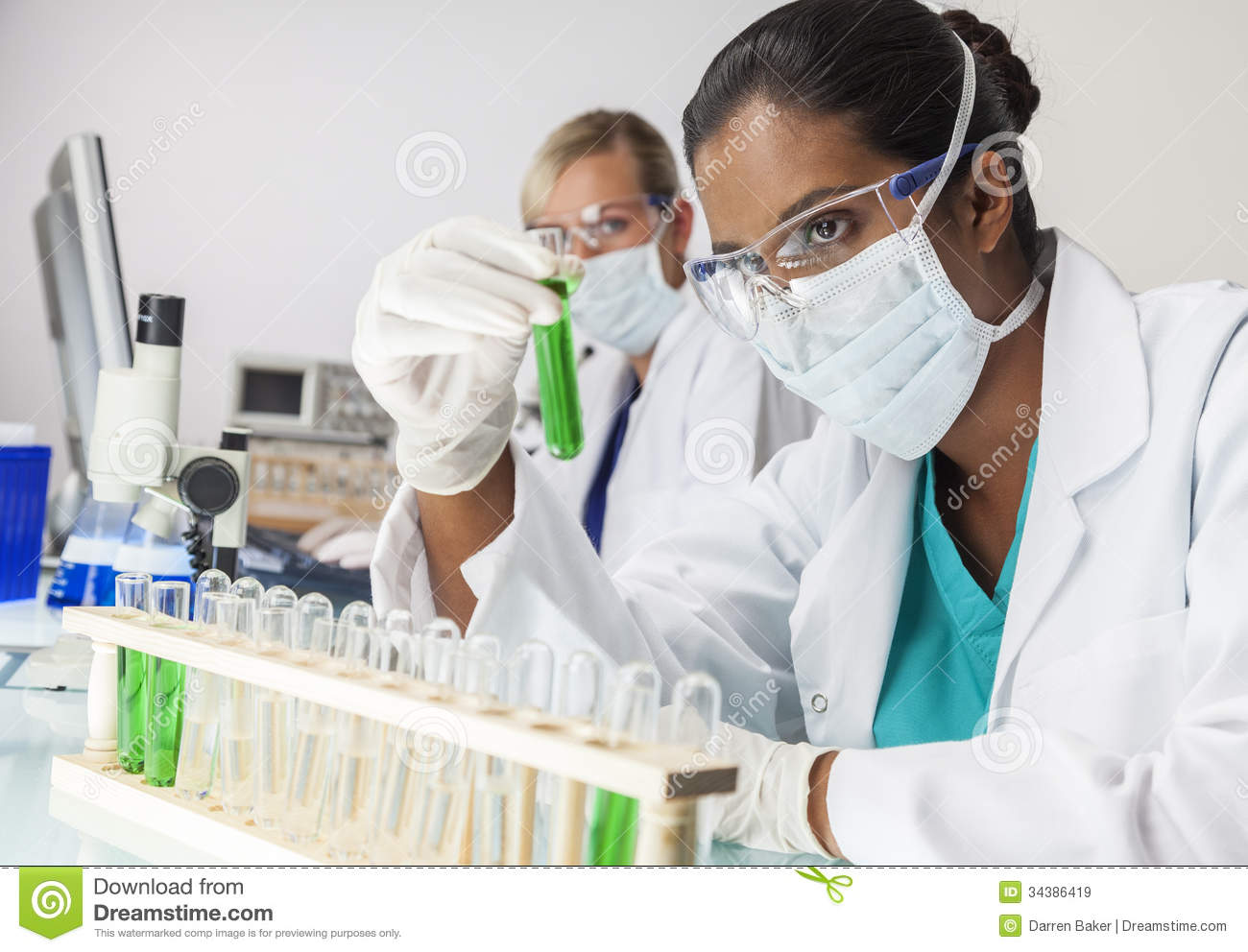 Asian Indian Female Laboratory Scientist Green Test Tube ...