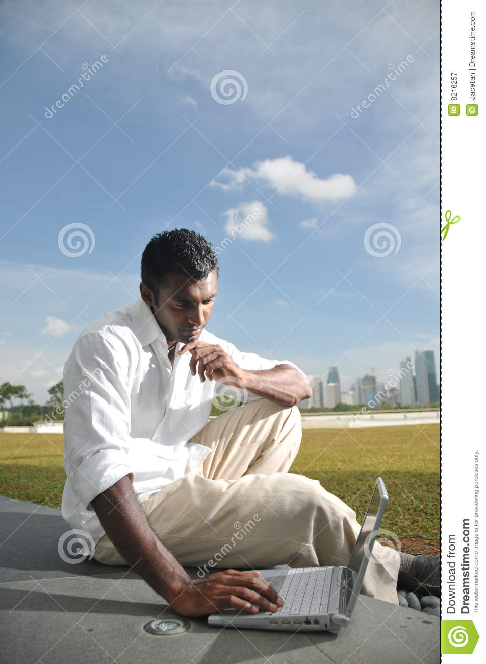 Asian Indian Man Surfing The Internet Wirelessly Stock Image