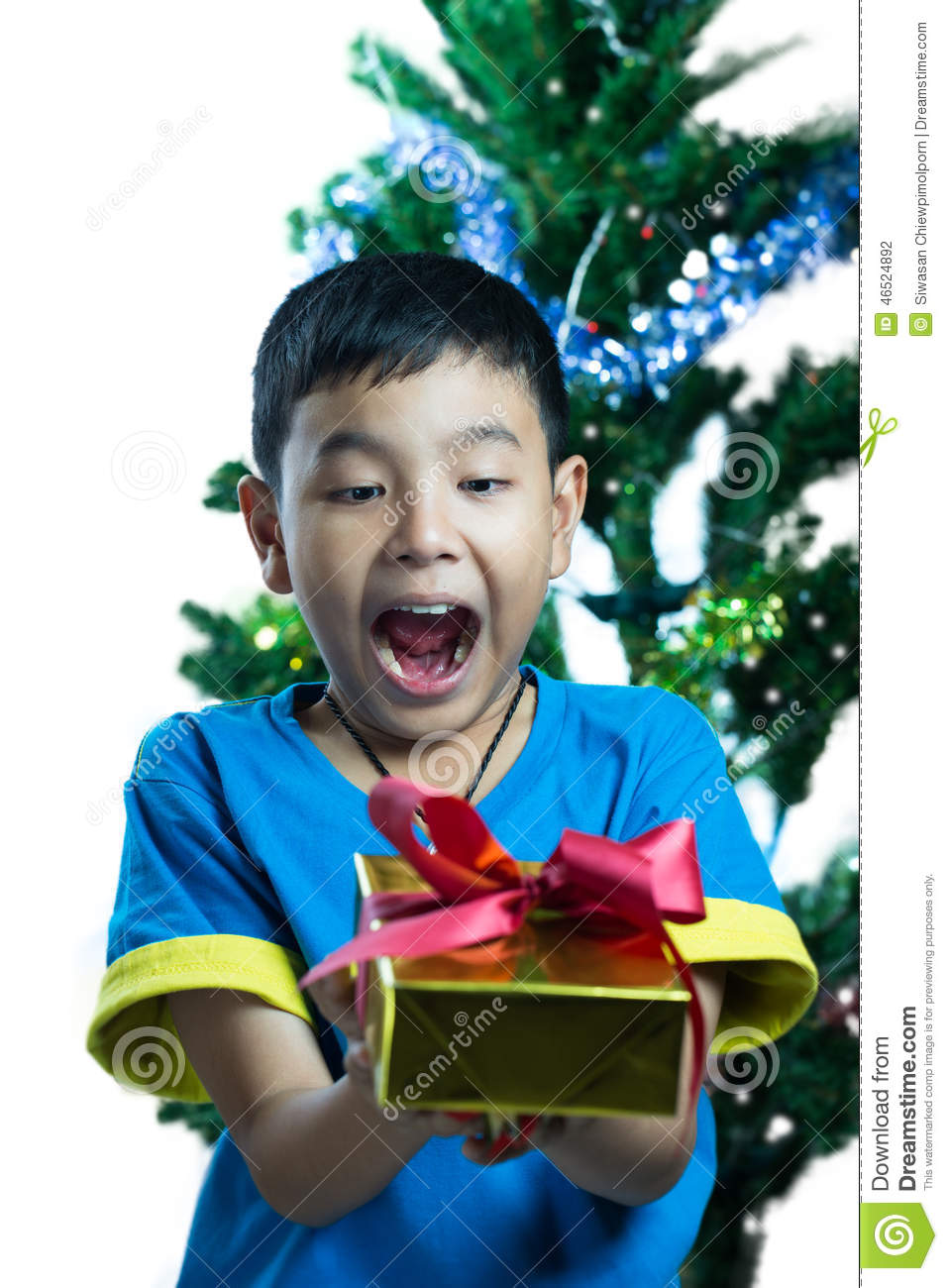 Asian Kid Exciting To Get A Christmas Gift Stock Photo