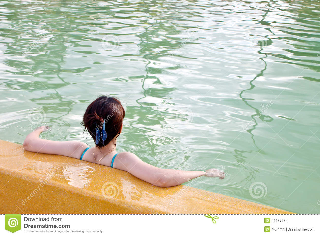 A asian lady relaxing in swimming pool