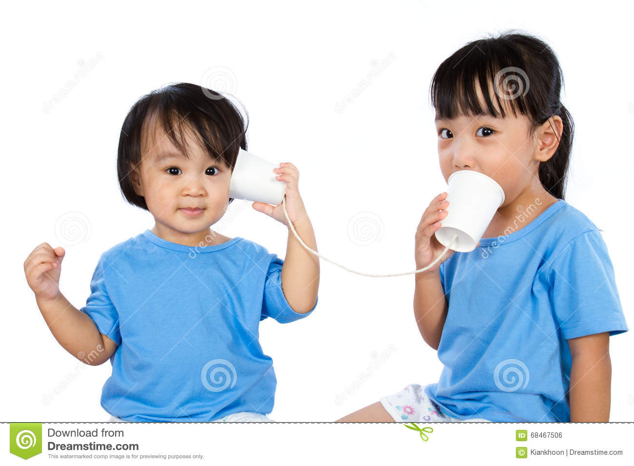 Asian Little Chinese Girls Playing with Paper Cups