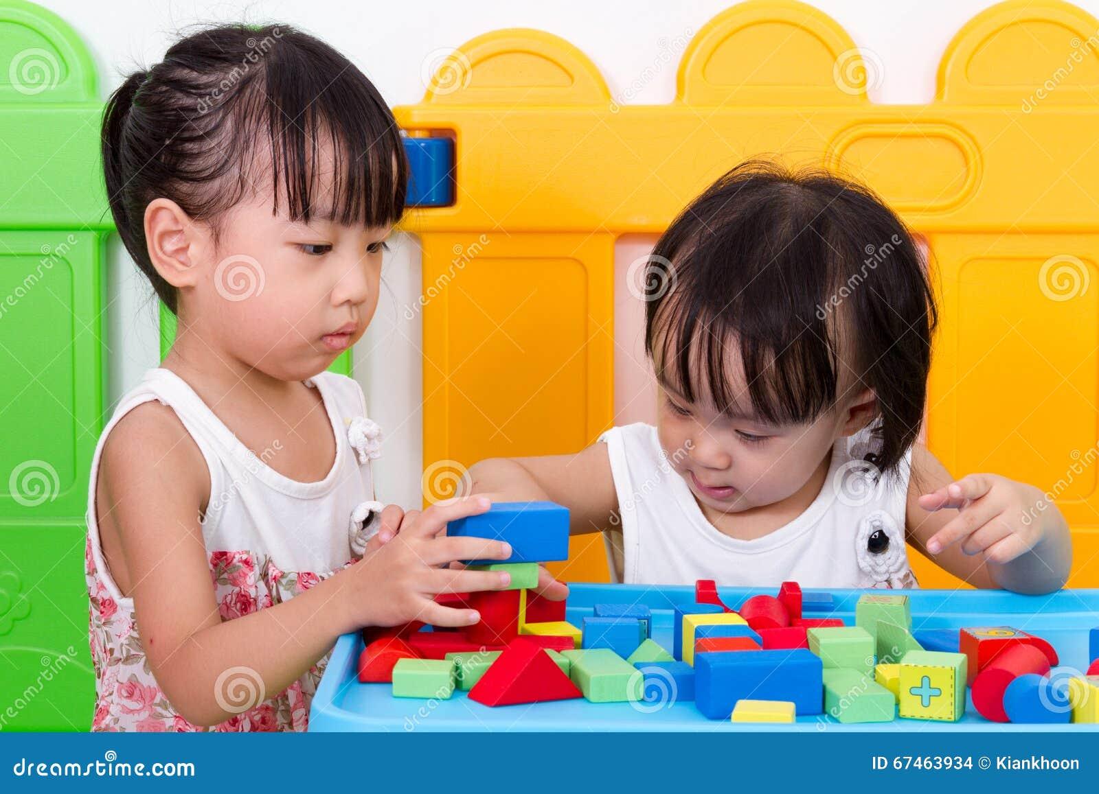Asian Little Chinese Girls Playing Wooden Blocks