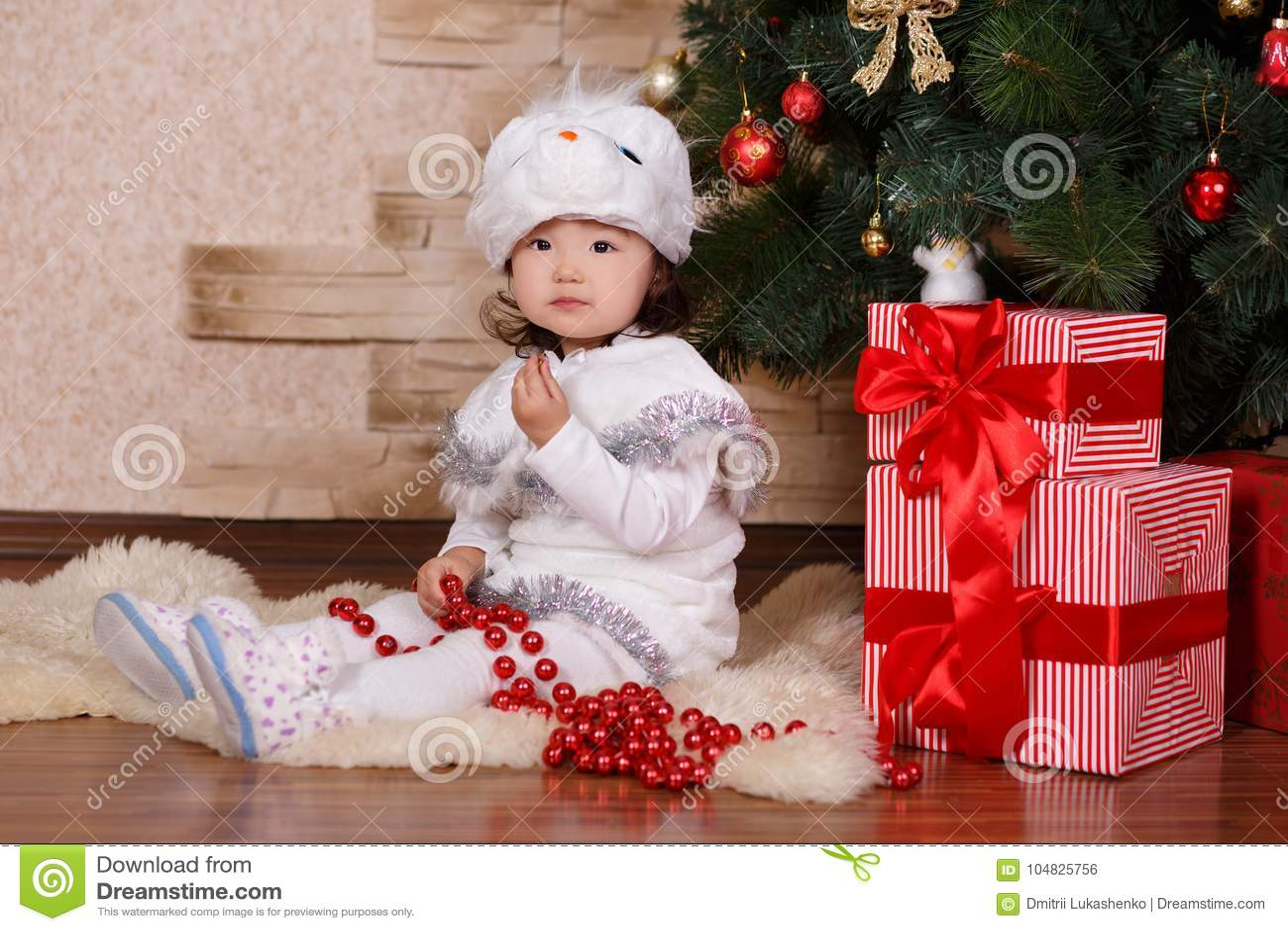 50848197009ec Asian little cute girl wearing casual dress posing close to new year  christmas green classic tree