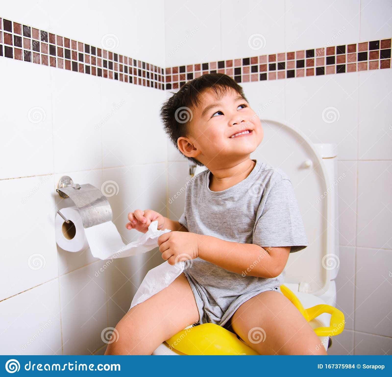 Asian 2 - 3 Years Old Toddler Boy Child Sitting On Toilet