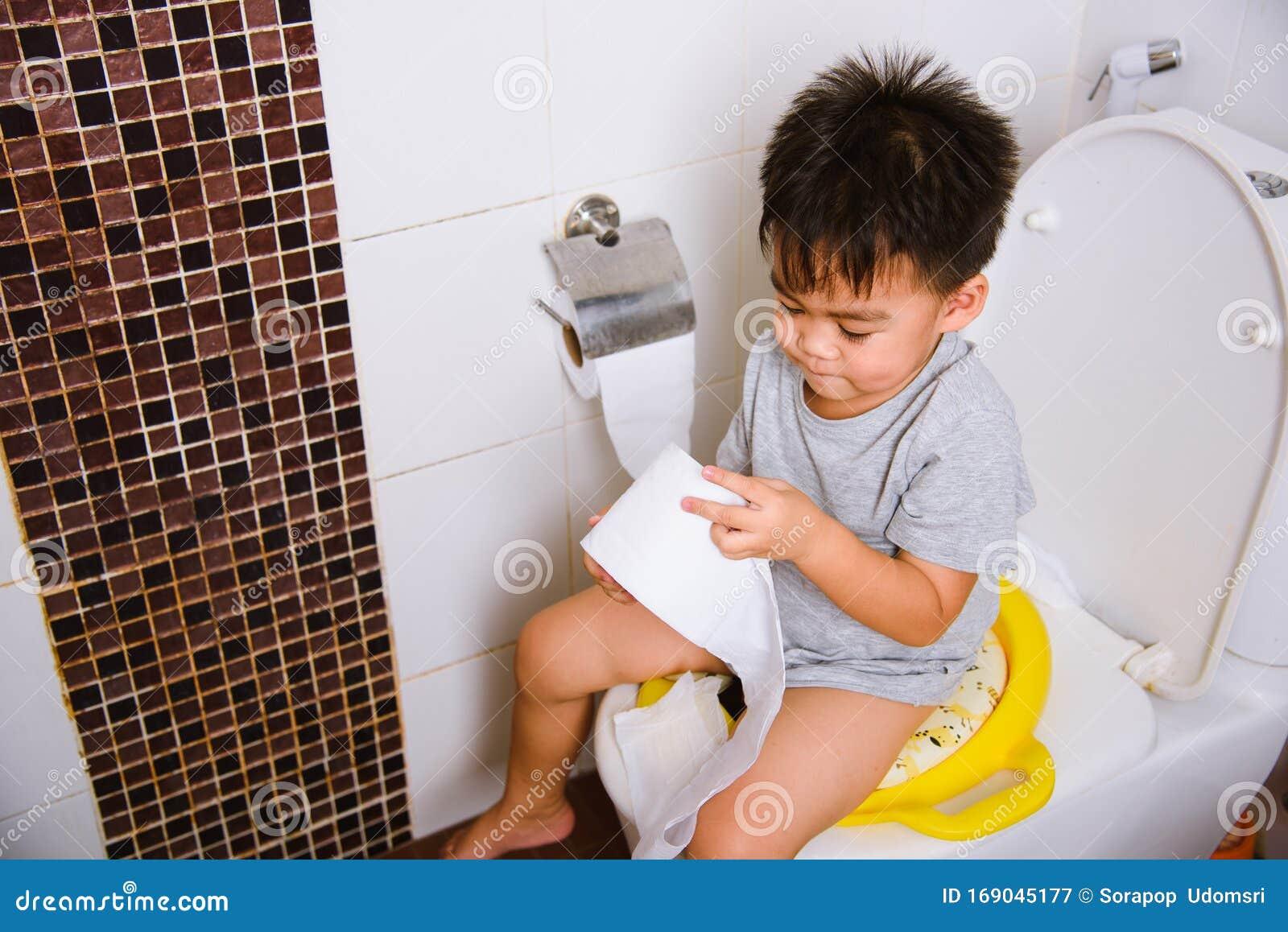 Asian Little Kid 2-3 Years Old Sitting On A Kid Bathroom