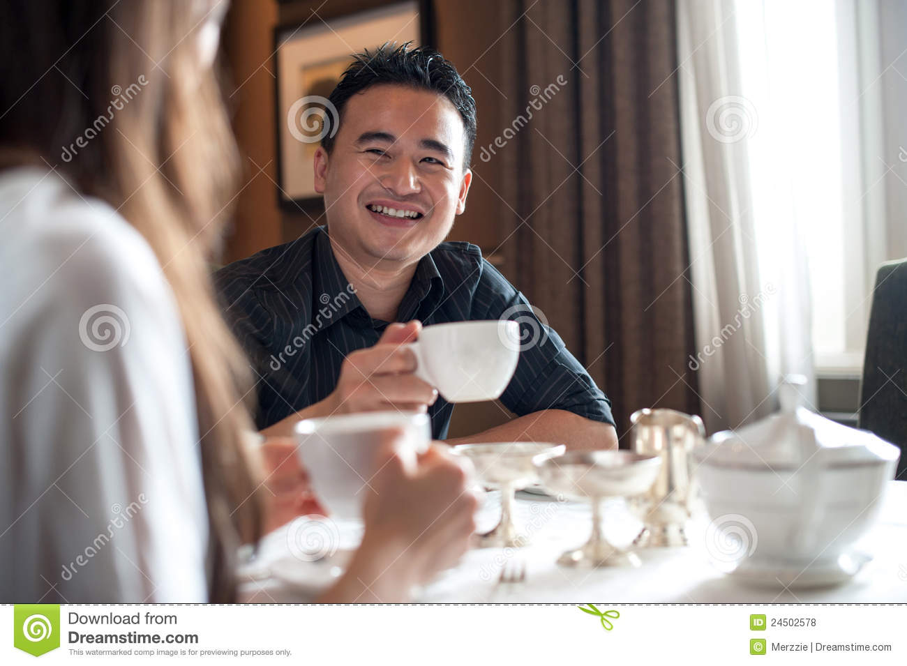 Asian Male at a Cafe