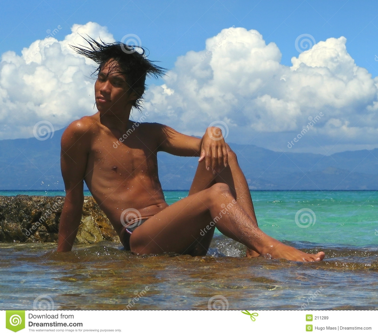 asian male on rocks on moalboal cebu philippines beach mr yes pr no 2