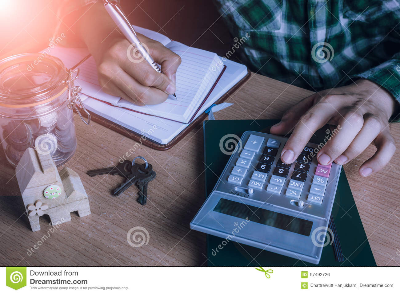 Asian man accountant or banker calculate finances / savings money or economy for rent home