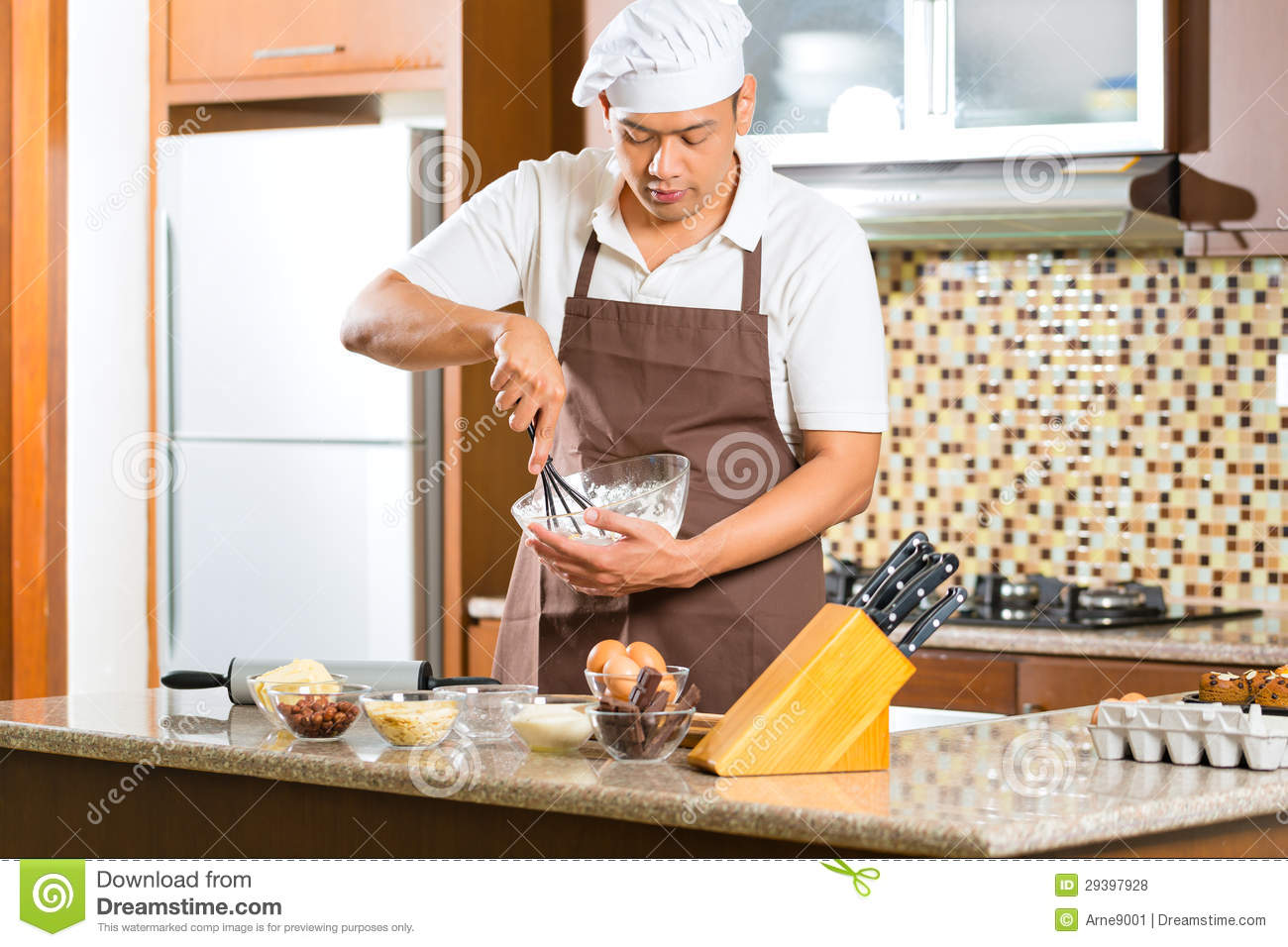 Kitchen For Baking ~ Asian man baking cake in home kitchen stock photo image