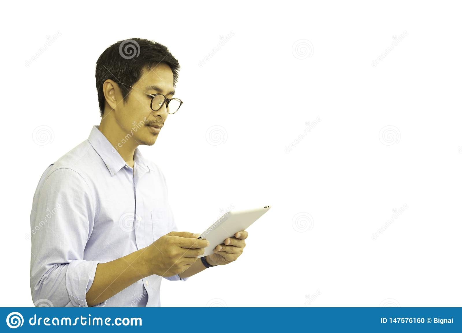Asian man with eyeglasses looking at tablet isolated in clipping path.