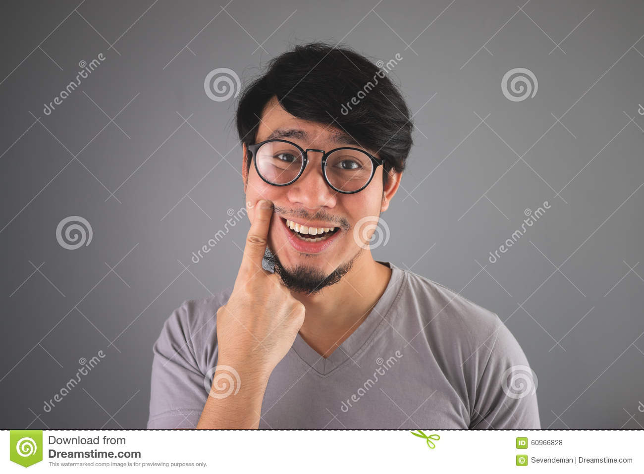 Asian man is faking his smile.