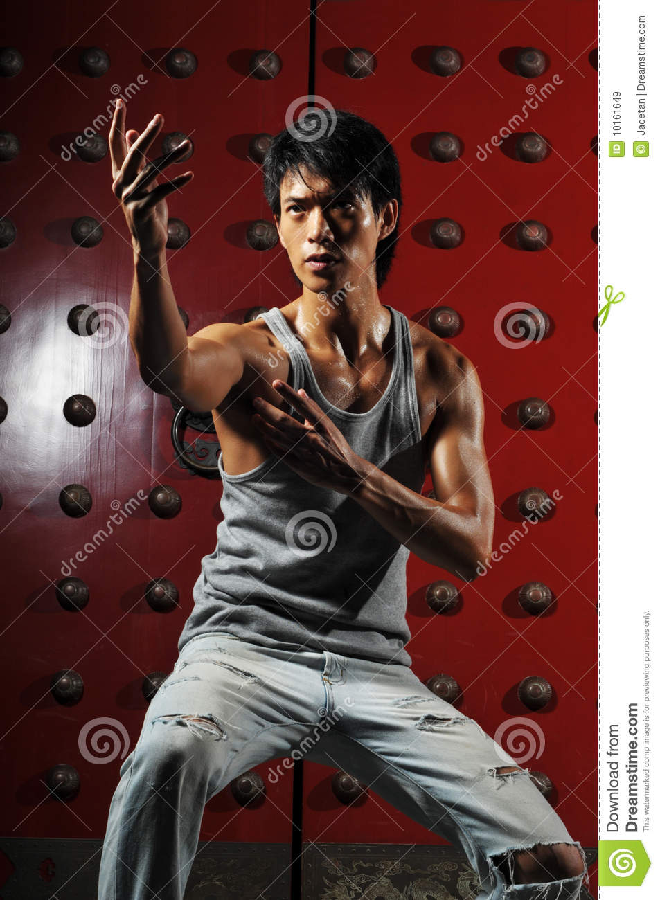 Asian Man In Fighting Action